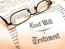 Glasses on top of a Last Will and Testament